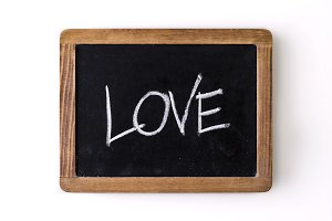 "Word ""Love"" written on a slate"