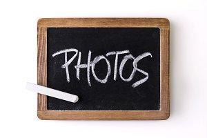 "Word ""Photos"" written on a slate"