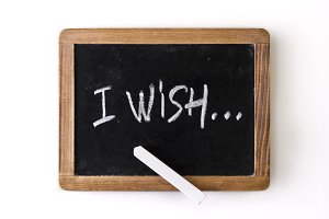 "Phrase ""I wish"" written on a slate"