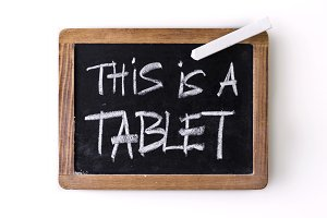 "Handwritten words ""this is a tablet"""