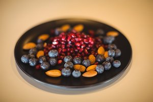 Pomegranate, blueberry and almond in a plate