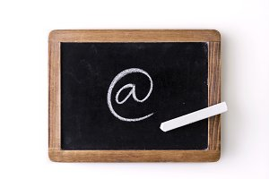 "Character ""@"" written on a slate"