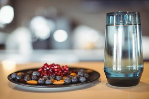 Plate of snacks and water glass on table