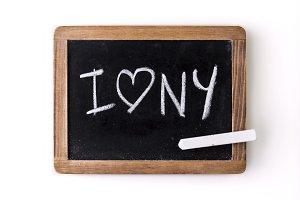 """I love NY"" written on a slate"
