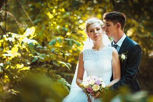 bride and groom on the forest background