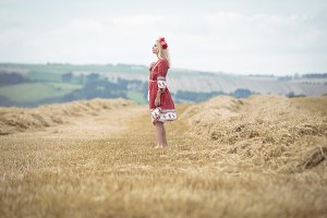 Blonde woman standing in field