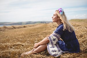 Blonde woman relaxing in field