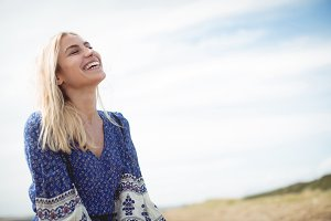 Blonde woman laughing in field