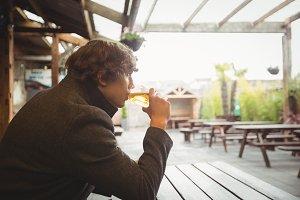 Man having glass of beer
