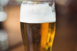 Glass of beer in bar counter