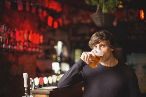 Portrait of man having a glass of beer