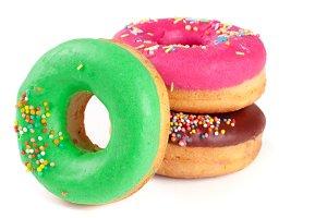 three glazed donut isolated on white background