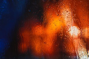 Drops of rain on the window of the car in the evening