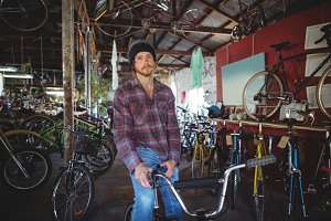 Portrait of mechanic sitting on bicycle