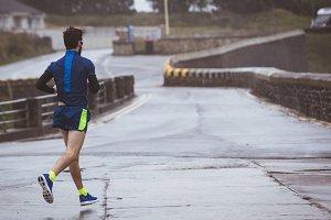 Athlete running on road