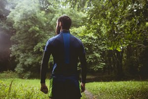Athlete standing in forest