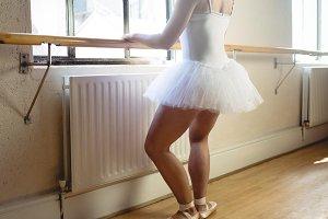 Ballerina practising ballet dance at barre