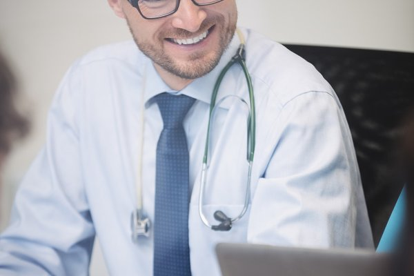 Smiling doctor in meeting