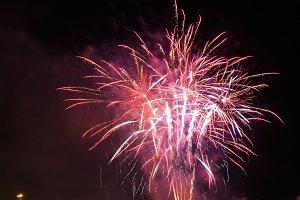 Fireworks against the night city skyline .