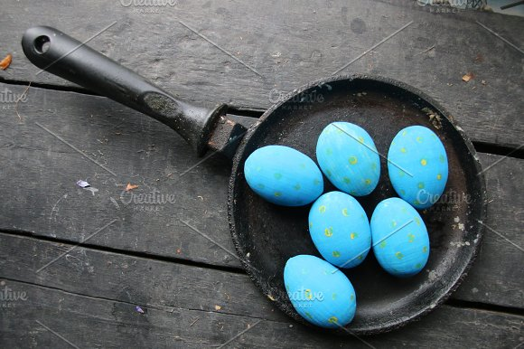 Easter Eggs In A Frying Pan On Vintage Table