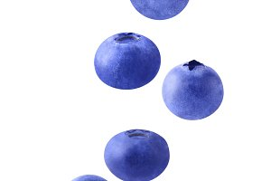 Isolated flying blueberries