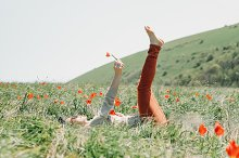 Woman relaxing on flower field.