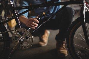 Mechanic examining bicycle