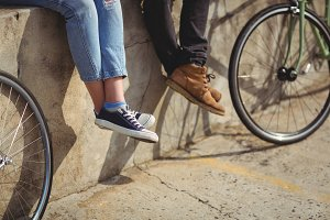 Couple sitting on wall