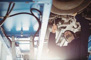 Mechanic fixing a car