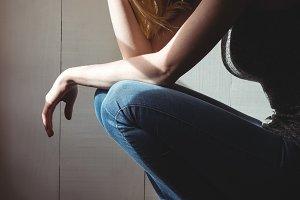 Tensed woman sitting on steps