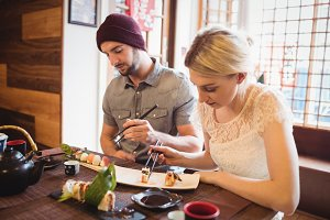 Couple eating sushi