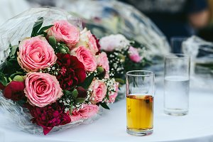 Glass with apple juice and bouquet
