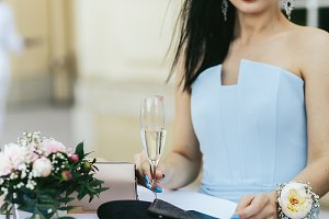Woman holds a glass of champagne