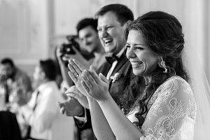 Applauding wedding couple