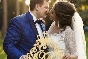 Beautiful newlyweds and evening sun