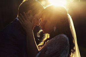 Golden evening sun over newlyweds