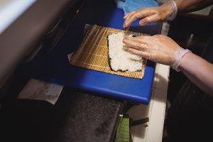 Chef hand preparing sushi