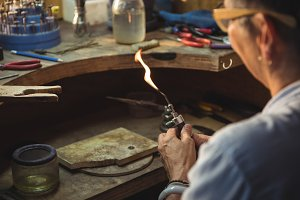 Craftswoman using blow torch
