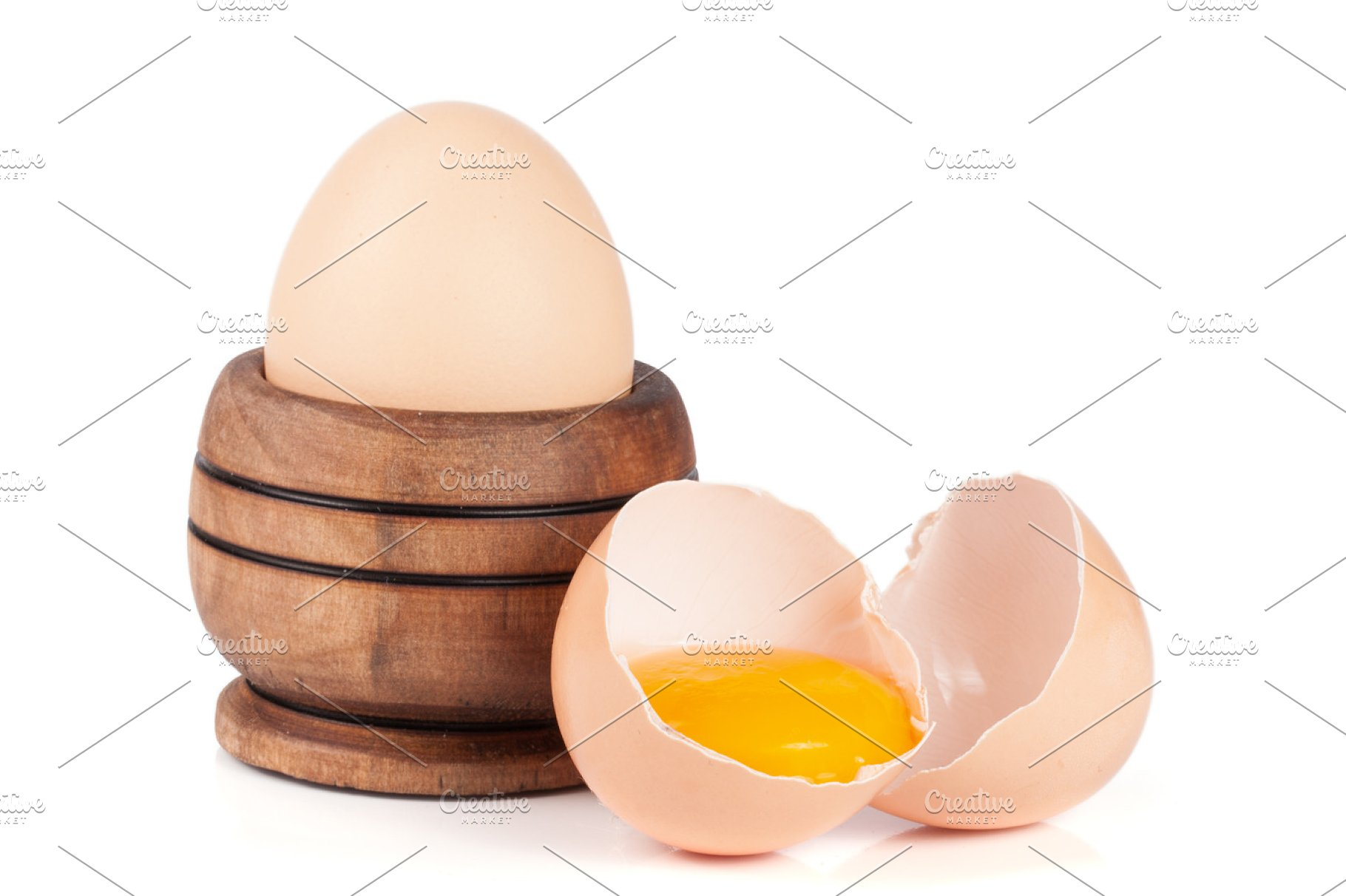 Whole Egg And Broken Egg In A Wooden Bowl Isolated On White Background
