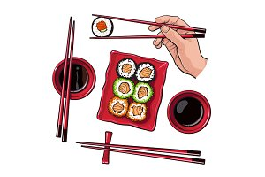 Japanese sushi set, serving plate, hand holding chopsticks