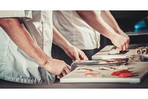 Chefs preparing sushi