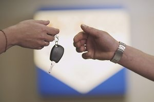 Car keys - woman client gives the keys of car for mechanic