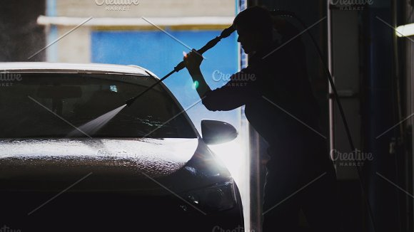 Automobile car washing in workshop - silhouette