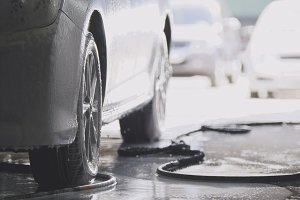 Washing the car in workshop - automobile in foam