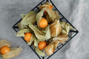 Top view on the physalis fruit in a black basket