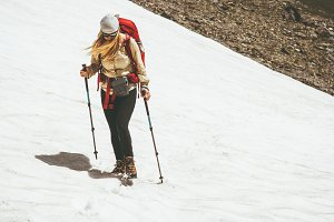 Traveler woman climbing