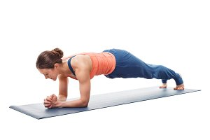 Woman doing Yoga asana Chaturanga dandasana  plank pose