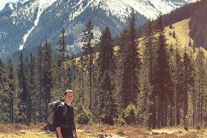 Tourist man on natural mountain