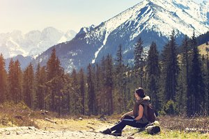 Woman sitting on natural mountain