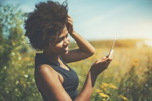Black girl on meadow